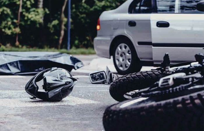 car and motor collision on accident prone road