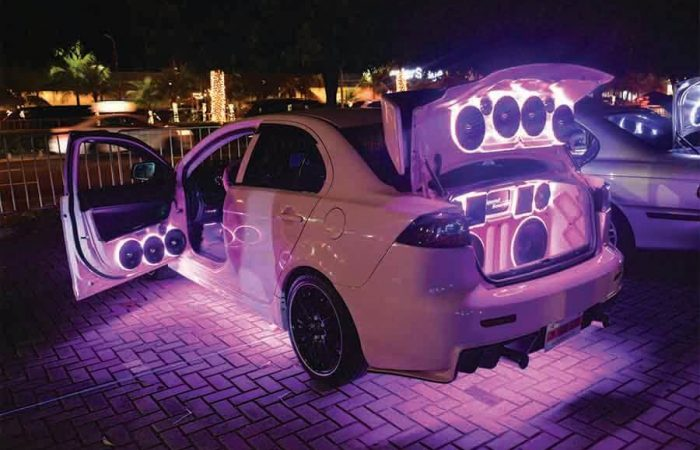 modified car with neon lights and speakers