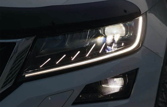 white car with aftermarket daytime running light