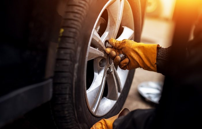 mechanic changing car tyres and rims