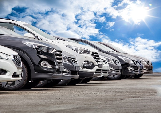 a row of parallel imported cars