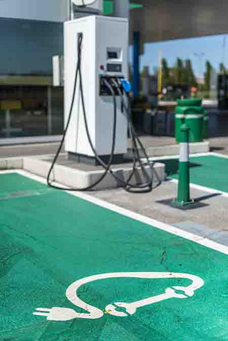 Electric Car Charging At Fuel Station