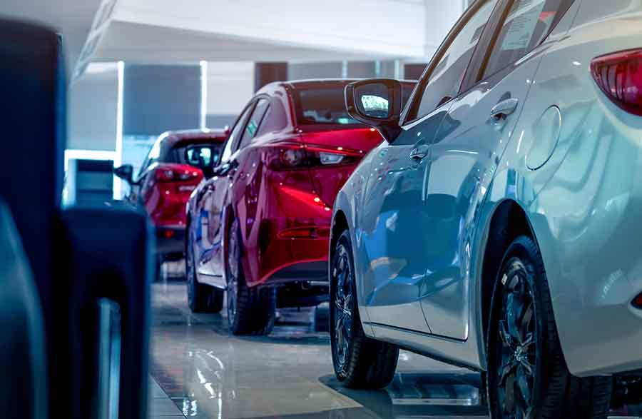 fleet of new cars in showroom