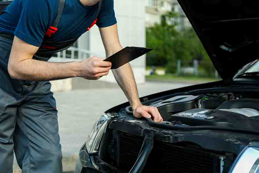 inspecting the condition of the car engine