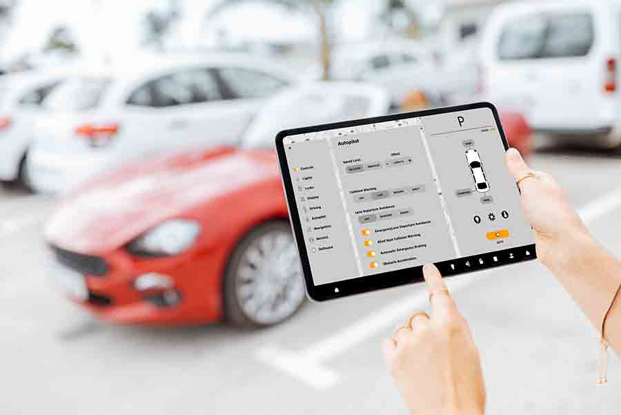 using a tablet to check the condition of the car mechanics